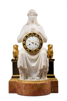 Attributed to Sculptor François Masson (1745-1807) <br/>Important White Marble Mantel Clock  <br/>Paris, early Empire period, circa 1805 <br/>Height 54 cm; width 31 cm; depth 21 cm <br/>