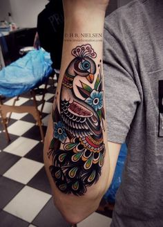 What a beautiful peacock tattoo!