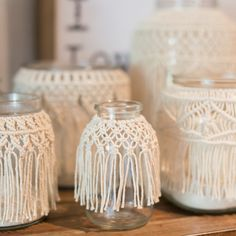 5 tall x 3.75 wide with 1.5 opening glass jar covered with 1.5 mm unbleached cotton macrame. Add some sand and a candle & it becomes the perfect bohemian candle holder. Fill it with flowers for a unique vase. Group several together for a table centerpiece. Great for weddings, home & holiday decor. Every item is handmade by me. No two are exactly alike. I like to think of them as perfectly imperfect. Hope you love these as much as I loved making them. This listing is for 1 x-small macrame…