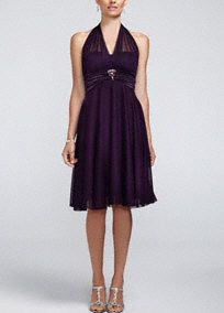 This is one dress that is sure to be your go-to favorite time and time again.   Illusion halter neckline ties in the back for a perfect fit.  Charmeuse trim and beaded brooch detail accent the empire waist of the short and flirty skirt.  Imported polyester. Fully lined. Hand wash only.  Please Note: Sale pricing varies according to color. Please click color and size to view pricing.Also available in plus sizes as Style 9006DB0W.