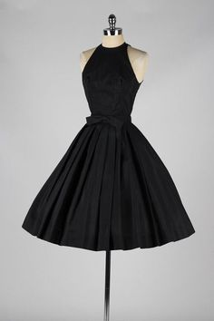 Vintage 1950's Suzy Perette Black Halter Dress | From a collection of rare vintage evening dresses at http://www.1stdibs.com/fashion/clothing/evening-dresses/: