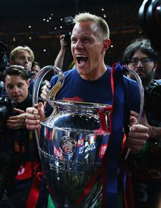 Marc-Andre ter Stegen of Barcelona celebrates with the trophy after the UEFA Champions League Final between Juventus and FC Barcelona at Olympiastadion on June 6, 2015 in Berlin, Germany.