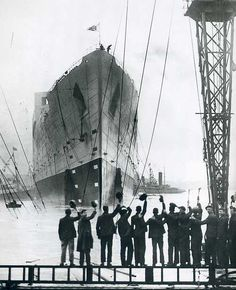 Unknown photographer / AP Photo, Sep. 26, 1934, Launch of RMS Queen Mary --- The RMS Queen Mary was a ocean liner that sailed primarily in the North Atlantic Ocean from 1936 to 1967 for the Cunard Line.  ¶ 30 years later my father would sail in 2nd Class with his family and grandmum would dance w Telly Savalas in the 1st Class Ballroom.
