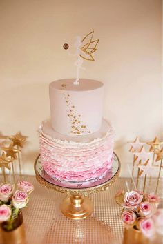 Tinkerbell Fairy Topper on a Pink Frilled Cake...so pretty!