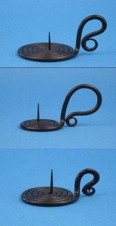 I was told by an historical blacksmith that a candle holder like these was unearthed at a dig near Colonial Williamsburg. Rods of wrought iron were imported from England for making nails but were also used for items like this. Metal Projects, Welding Projects, Metal Crafts, Blacksmith Forge, Sculpture Metal, La Forge, Blacksmith Projects, Wooden Candle Holders, Forging Metal