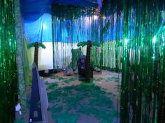 Basement decorated as the rainforest. Including blow up trees and cardboard animal standees. Safari Theme Party, Jungle Party, Jungle Safari, Jungle Theme, Vbs Themes, Party Themes, Party Ideas, Rainforest Theme, Amazon Rainforest