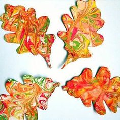 Fall Arts and Crafts For Kids Marbeling Paper then cutting out leaf shapes