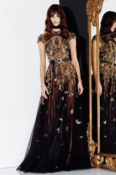 Zuhair Murad F/W 16/17: An exquisite black sheer gown with gold embellishments, belt, and cap sleeves.