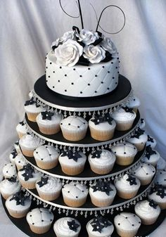 "It perfect for me cause I love #cupcakes! Unique #wedding cake! I had my 30th bday ""cake"" like this too! :)"