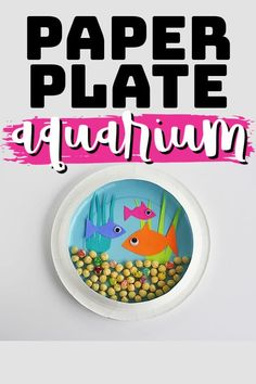 The cuteness is inside two paper plates made to look like an aquarium. It's a classic kid's craft! #diyaquarium #kidscrafts #recycledcrafts #recycledkidscrafts #paperplatecrafts #recycledpaperplate #summercrafts #beachcrafts #craftsbyamanda