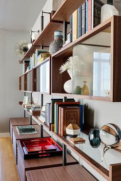 bookshelf at Boston Residence by Andra Birkerts Design | HomeAdore