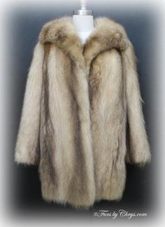 Bleached Raccoon Fur Jacket #BR678; Excellent Condition; Size range: 6 - 10. This is a beautiful genuine bleached raccoon fur jacket. It has a Tibor's Furs label, and features a large wing-style collar. There are two exterior pockets, one interior horizontal pocket, and a second interior pocket with an embroidered name monogram on it, with a monogram hidden on the lining underneath. The lining is a solid rose color. The fur of this jacket is soft and very warm. You will love it!