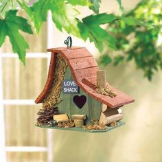 """A great place for feathered friends to bill and coo . . . the """"Love Shack"""" birdhouse. Rustic wood construction will blend nicely with your garden or patio. Secure ring on roof for easy hanging. Dimens"""