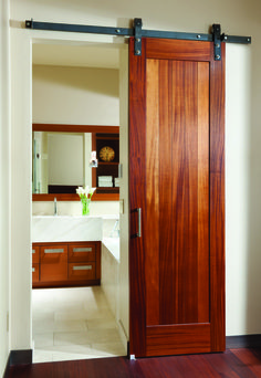 Big Sky Journal - Custom-made sliding barn doors outfit the bathroom and guest suites in the lower level.