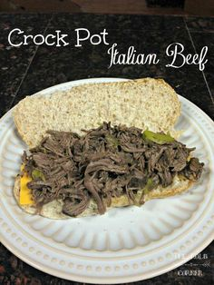 Looking for a simple weeknight dinner?  This Italian Beef made in the Crock Pot is really easy to throw together in the morning, and it's ready when you get home!  #crockpot #recipe #thekolbcorner