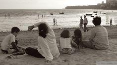 Family on Chowpatty Beach in Mumbai, India