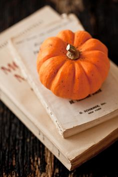 books, pumpkin.......AND a cozy sweater, warm booties, a cup of tea & a blanket <3)