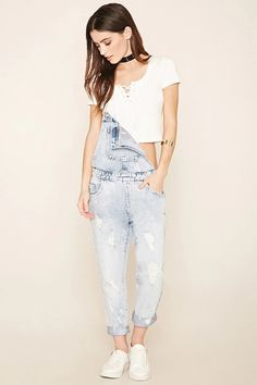 A pair of denim overalls with a bib patch pocket, five-pocket construction, mock fly, and distressing on the front and back. #f21denim