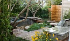 outdoor showerm wood deck, paths, water, flowers, trees. love it all.