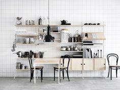 String shelving unit (http://www.nest.co.uk/browse/brand/string) and Thonet (http://www.nest.co.uk/thonet) chairs via BLACKBIRD