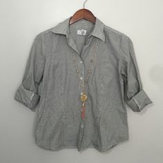 Gingham Button-up Shirt Button-ups are so fun to give a little edge to any outfit. The darting in the bust gives this a nice feminine fit. Add your favorite accessories and some or roll up the sleeves and put a t-shirt underneath with some sneakers and you're ready to go! LOFT Tops Button Down Shirts
