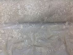 Check out this item in my Etsy shop https://www.etsy.com/listing/237850199/bridal-wedding-beaded-mesh-fabric-lace