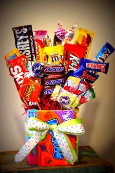 DIY Candy Bouquet-never thought of using boxes as the vase. So clever!