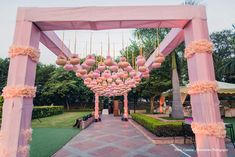 The duo exchanged their vows Taj Diplomatic Enclave, Delhi the next day, and the colors for the function were pastel pink, peach, and white. Inverted whites roses suspended using white ribbons made for the ceiling of the mandap that was supported by pillars of flowers matching the color scheme. White tuberoses were used to create a backdrop that also lit up, and chairs covered in lace added a delicate touch to the setup. #weddingdecor #decor #weddingdecorideas #weddingdetails #weddingvenue…