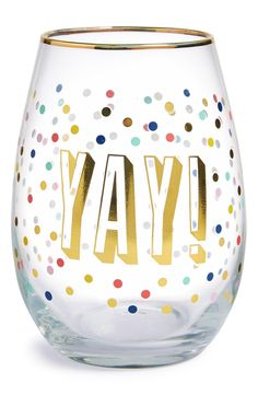 A gold metallic foil finish and celebratory exclamation make this stemless wine glass covered in confetti like dots a perfect addition to any festive occasion.