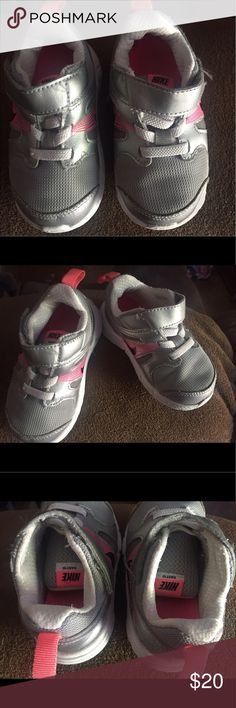 f58c25fc28 Silver and pink shoes. Only worn a handful of times. Toddler Nike ...