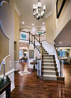 Love the welcoming openness of this foyer...maybe add a wider staircase and overemphasized railing for personality and a throwback feel