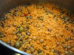Arroz con gandules, or rice with pigeon peas, is a traditional Puerto Rican side dish. Rice is cooked with homemade sofrito, capers, olives,...