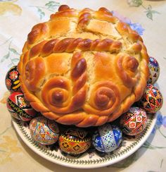 Paska: traditional Ukrainian rich Easter bread. It is shaped in a short round form. The top of the paska is decorated with typical Easter symbols, such as roses or crosses.