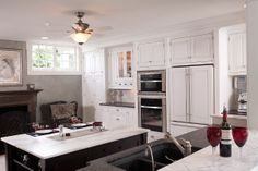 Double oven installed above a drawer to a raised height. custom kitchen designs by Mullet Cabinet in Millersburg, Ohio
