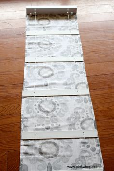 Simple No Sew Roman Blind Tutorial - Place the blinds on top of the fabric and decide on the spacing