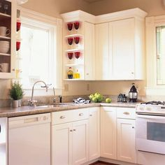 Small white kitchen with red accents