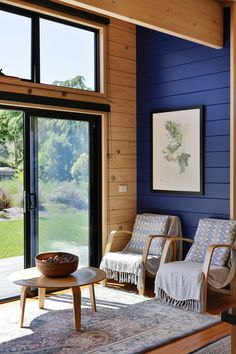 Striking dark painted timber walls in a Lockwood holiday home in Nelson House Paint Interior, Interior Design, Phoenix Design, Timber Walls, Cabin Interiors, Living Room Flooring, The Ranch, Blue Walls, Log Homes