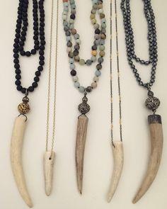 Deer antler pendant necklaces.