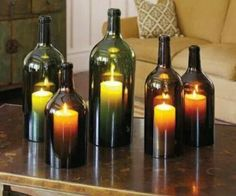 Olive oil bottles....what a great way to keep candle lit outside....