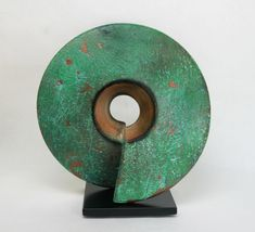 The simple yet striking form of this wheel-thrown ceramic sculpture has great presence. After the second firing, Williams applies copper paint and finishes with a turquoise patina creating a remarkably textured surface. Mounted on a steel base wit. Modern Art Sculpture, Abstract Sculpture, Ceramic Sculptures, Rose Clock, Copper Paint, Bronze Patina, Compass Rose, Contemporary Ceramics, Outdoor Art