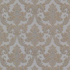 This magnificent damask wallpaper creates a look like your walls are adorned in a luxurious fabric. Sophisticated pearl grey, with a shimmering brass patina and raised blowing ink effects.