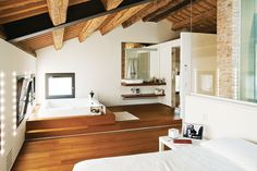 """The top floor holds the Chiavellis' bedroom suite, with a dressing room and built-in spa. """"The farmers dried their crops up here,"""" says Chiavelli. """"We knew right away this was the spot that we wanted to have our own room."""""""