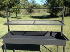 Charcoal Catering Grill with Adjustable Grill Grate can be equipped with a 95 lb. whole animal rotisserie or a 44 skewer kebob/churrasco rot...