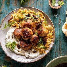 One Skillet Greek Meatballs and Lemon Butter Orzo with Whipped Feta Pan-seared Greek seasoned chicken meatballs, cooked together with lemon butter orzo pasta, for a complete dinner made in just one skillet. Greek Meatballs, Chicken Meatballs, Orzo, Whipped Feta, Greek Chicken, Chicken Dips, Half Baked Harvest, Lemon Butter, Chicken Seasoning