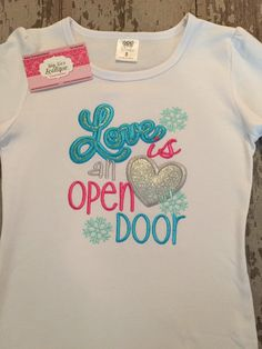 A personal favorite from my Etsy shop https://www.etsy.com/listing/260365750/love-is-an-open-door-appliqued-shirt