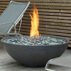 Love this gas bonfire bowl with river rock for the patio! Perfect accent for the river rock edging.