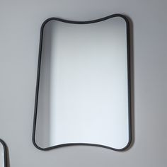 OUT OF STOCK UNTIL THE END OF JUNE - AVAILABLE FOR BACK ORDER     This curved edge black rectangle wall mirror is the ultimate in modern style. The gorgeous mirror has perfected understated elegance beautifully.  Its cutting edge design would look right at home in any contemporary décor. The stunning curvaceous shape