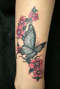 Butterfly With Flowers Tattoo Design Ideas - http://tattooideastrend.com/butterfly-with-flowers-tattoo-design-ideas/ -