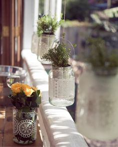 Moccona coffee jars used as vases for a table centrepiece