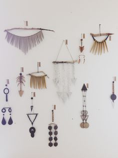 Collection of objects made of driftwood and shells on a feature wall-Heather Levine